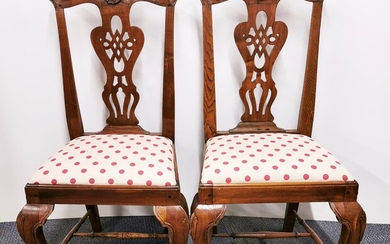A pair of early 19th century carved walnut side chairs.