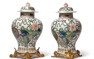 A pair of ormolou mounted famille-verte jars and covers, Qing dynasty, Kangxi period   清康熙 五彩瑞獅戲球蓋罐一對, A pair of ormolou mounted famille-verte jars and covers, Qing dynasty, Kangxi period   清康熙 五彩瑞獅戲球蓋罐一對