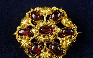 An early to mid 19th century gold foil back garnet cannetille brooch, with locket reverse.