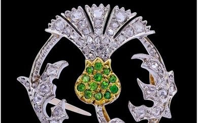 DEMANTOID GARNET AND DIAMOND THISTLE BROOCH, in precious yel...