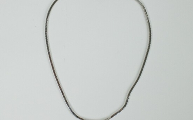 White gold necklace with diamonds, emeralds, brilliants and marquis