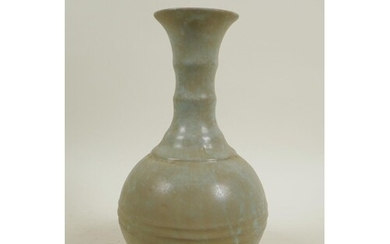 A Chinese celadon glazed pottery ring turned vase in the Son...