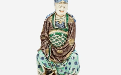 A Chinese famille verte-decorated Dehua porcelain figure of Guandi 德化窑五彩关帝像 The figure probably 18th century, the enamels possibly later 关帝像为十八世纪 珐琅或为后添