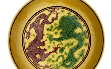 A Chinese yellow-ground aubergine and green-decorated saucer dish, Kangxi mark...