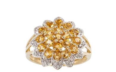 A DIAMOND AND CITRINE CLUSTER RING, the central citrine clus...