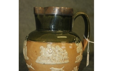 A Doulton Lambeth stoneware ale jug, decorated in relief wit...