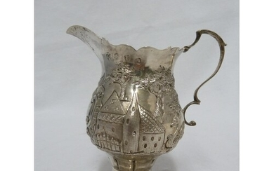 A George III silver cream jug of baluster form with leaf cap...