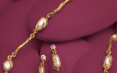 A KESHI PEARL AND GOLD DEMI-PARURE