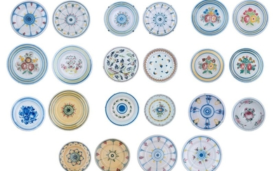 A large collection of 'faïence populaire' chargers, 19th - 20thC, ø 29,5 - 38 cm
