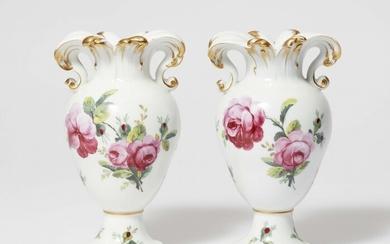 A pair of Berlin KPM porcelain vases with rose decor