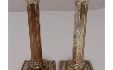 A pair of Victorian hallmarked silver table candlesticks of ...