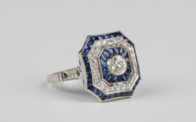 A platinum, diamond and sapphire canted corner square cluster ring, collet set with the principal ci