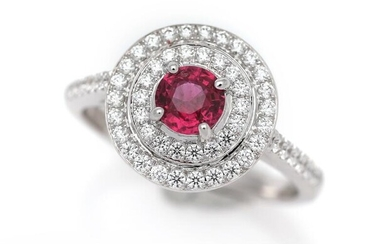 NOT SOLD. A ruby and diamond ring set with a ruby encircled by numerous diamonds, mounted in 18k white gold. Size 54. – Bruun Rasmussen Auctioneers of Fine Art
