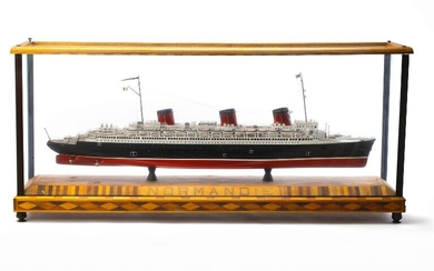 A ship model of Normandie, painted wood. In glass and wood cabinet. H. 56 cm L. 122 cm W. 28 cm. – Bruun Rasmussen Auctioneers of Fine Art