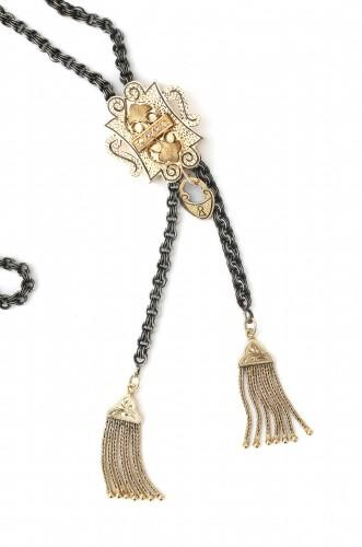 A silver and gold necklace with a 14 karat gold slide pendant and tassels. Provenance: The Netherlands. Maker's mark at necklace: +FaH, Homberg, n.v.H., Amsterdam, 1966-1996. The slide pendant is probably of earlier date. Gross weight: 47.3 g.