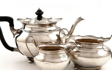 A three-piece late-Victorian Scottish silver tea set, by Hamilton and...