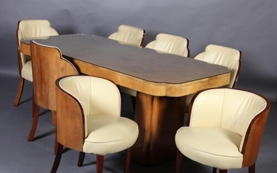 An Art Deco figured and crossbanded walnut dining table and ...
