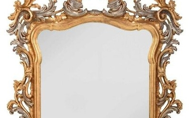 Baroque Style Carved, Silvered, and Gilt Beveled Mirror