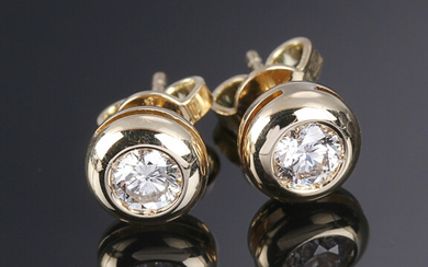 A pair of diamond solitaire ear studs in 18K gold, totalling approximately 0.61 ct. (2)