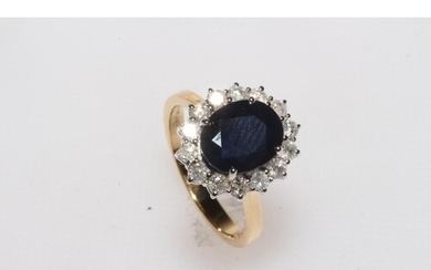 Sapphire and diamond 18 carat gold cluster ring, having oval...