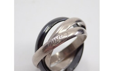 A 18ct gold ring signed Cartier, showing as finger size R/S