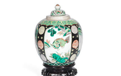 A 19th century Chinese porcelain Famille vert vase with matched cover
