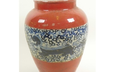 A Chinese porcelain baluster vase with red glaze and blue an...