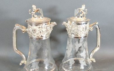 A Pair of Silver Plated and Engraved Glass Claret Jugs each ...