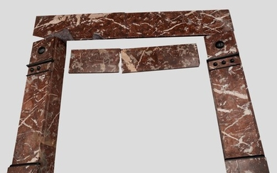 A VICTORAN MARBLE FIREPLACE of variegated brown and white co...