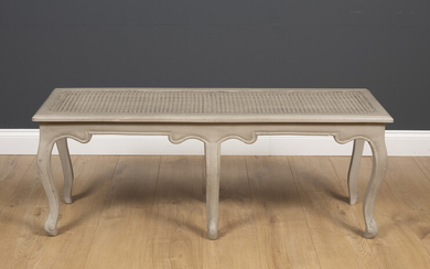 A grey painted 18th century French style window seat