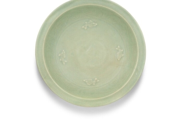 A large Longquan celadon 'fish' dish, Early Ming dynasty | 明初 龍泉青釉貼花魚紋折沿盤, A large Longquan celadon 'fish' dish, Early Ming dynasty | 明初 龍泉青釉貼花魚紋折沿盤