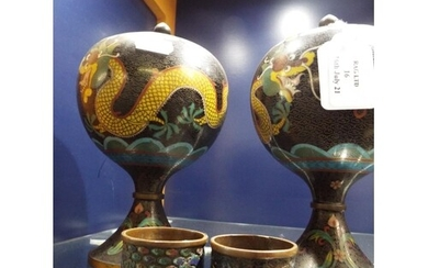 A pair of Chinese Cloisonné lidded pots with five toed drago...