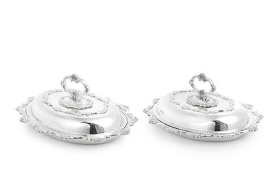 A pair of silver entrée dishes and covers