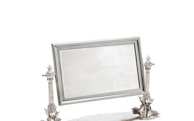 A silver dressing table mirror