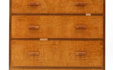 An Art Deco walnut and maple chest of drawers