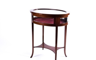 An Edwardian inlaid mahogany oval bijouterie table with out ...