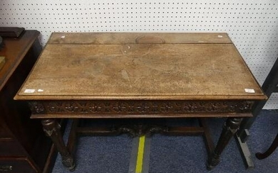 An early 20thC Continental oak Side / Console Table, with fo...