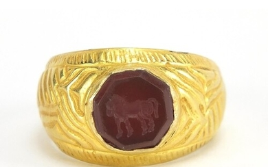 Antique unmarked gold intaglio seal ring carved with a horse...