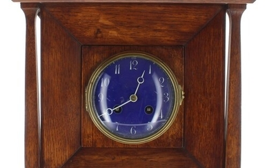 Arts & Crafts oak two train mantel clock in the manner o...