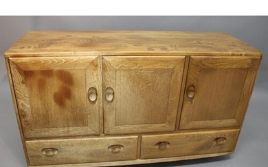 ERCOL SIDEBOARD a light elm sideboard with a two door cupboa...