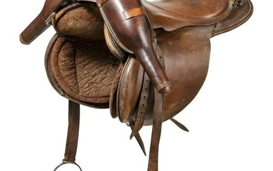 Saddle made of brown leather with pistol holster, 19th