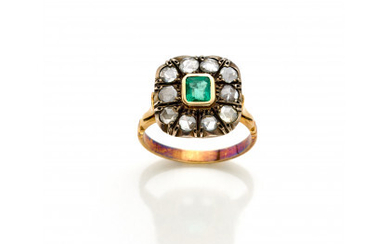 Silver and yellow gold cluster ring with rose cut diamonds and a small step cut emerald g 5.78 circa size…Read more