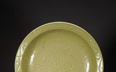A CHINESE CELADON GLAZED 'FLOWERS' CHARGER