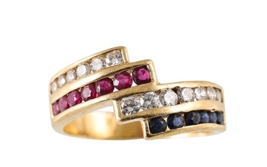 A DIAMOND, SAPPHIRE AND RUBY CLUSTER RING, of cross over des...