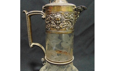 A Victorian hallmarked silver and glass claret jug, the body...