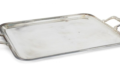 A large silver plated tray, by Christofle, of rectangular form with beaded edge and angular scrolling twin handles, 41.5cm wide, 65.7cm long (inc. handles)