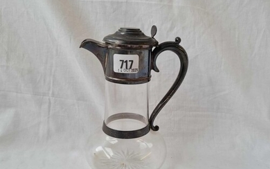 A late Victorian claret jug with silver hinges cover & glass...