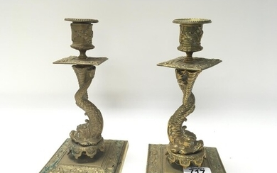 A pair of late Victorian brass candle sticks in the form of ...