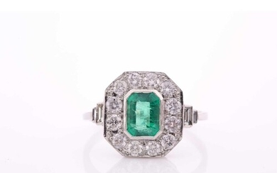 A platinum, diamond, and emerald ring, set with an emerald-c...