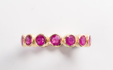 A ruby and eighteen karat gold eternity band ring